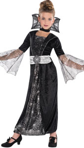 Dark Countess Costume, features a long black velour dress with a silver spider web tulle panel in the centre, coordinating bell sleeves and an attached silver belt with spider web decoration cinching the waist. A black choker with standing web-printed col